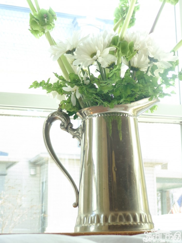 Maidenhead fern, Shasta daisies, and Bells of Ireland in a silver water pitcher from Fresh Flowers post on Shalavee.com