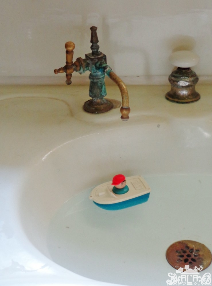 Charlie Fisher-Price floats in his boat from Shalavee.com
