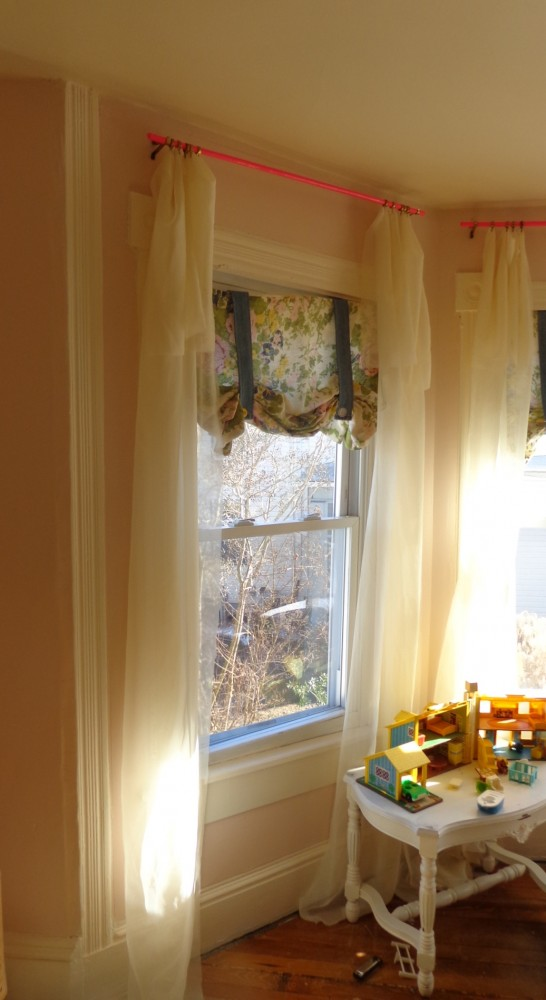 The pink curtain rods and roman shades in Fiona's room on Shalavee.com