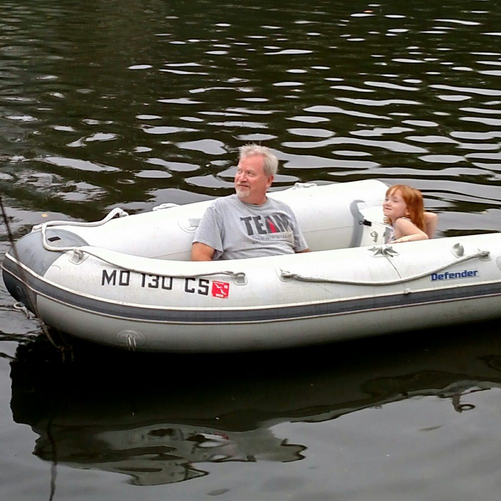 Unky John and Fiona in the dingy on Shalavee.com